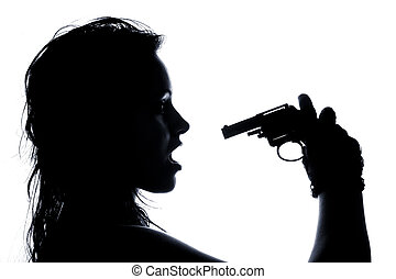 close-up portrait of beautiful girl pointing pistol at her...