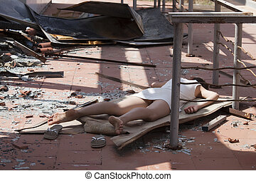 dead woman after explosion - model playing dead after a...