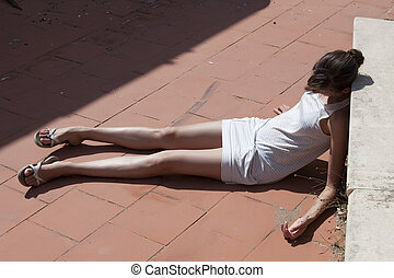 unconscious woman on the street - unconscious woman in short...