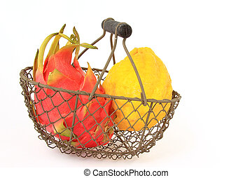 Exotic fruits - two exotic fruits in a small wire basket in...