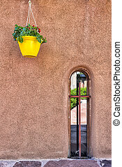 Adobe Wall in Chimayo, NM - Adobe wall featuring a hanging...