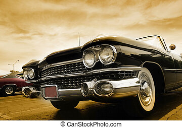 Classic Cars - Classic cars against cloudy sky in sepia...