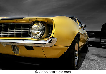 Yellow Muscle Car - Yellow muscle car against dark cloudy...
