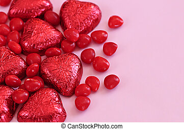 Valentine candy - Red Valentines candies and foil wrapped...