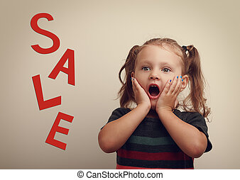 Surprising cute kid girl looking on sale text advertising...