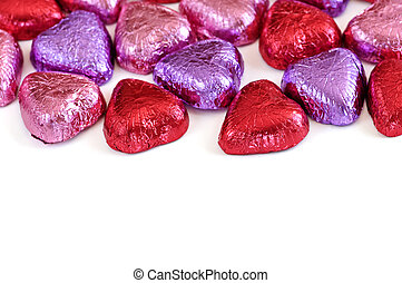Valentine candy - Valentines chocolates wrapped in red and...