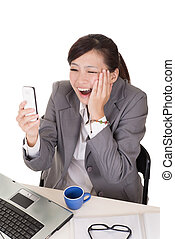 Confident business woman using cellphone and sitting on...