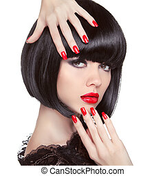 Beauty fashion brunette model portrait. Manicured nails. Red...