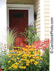 Welcome front door - Bright red front door surrounded by...