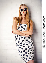 fascinating - Fashionable lady in polka-dot dress posing...