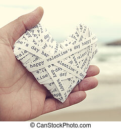 heart made-up with paper strips with the text happy...