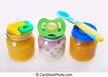 baby food in jars - assortment of three baby food in jars...