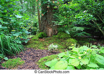 Fairy tale house - Little fairy tale door in a tree trunk.