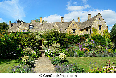 English manor with flower garden - An English manor built...