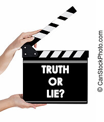 Hands holding a clapper board with TRUTH OR LIE? text