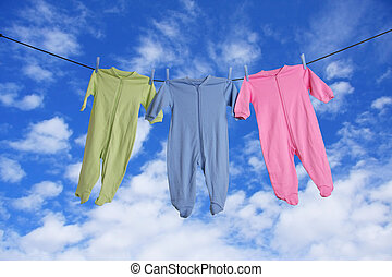 Baby laundry - Baby sleepers hanging on the clothesline
