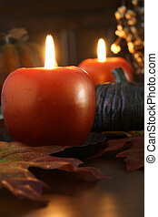 Autumn candle display - Apple shaped candles surrounded by...