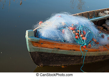 Boat with fishing nets - Old boat with fishing nets on its...