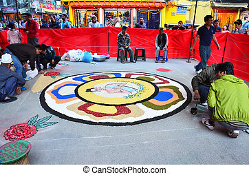 Celebrating Tihar Deepawali - Nepalese people painting art...