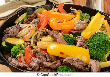 Beef stir fry - A healthy beef stir fry in a cast iron...