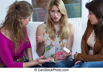 Pregnant woman - Young confused pregnant woman and her two...