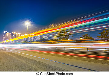 light trails on the city highway ,busy traffic at night...