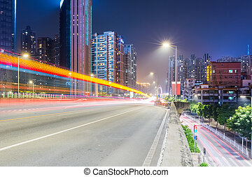 urban traffic night scene with light trails on overpass