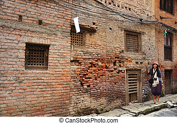 Thai women walking go to Patan Durbar Square is situated at...