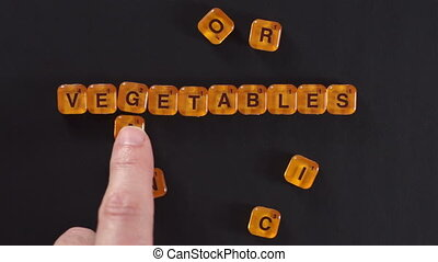 Blocks Spelling Organic Vegetables - A close up shot of a...