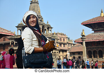 Traveler and Nepalese people at Patan Durbar Square is...
