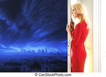 Elegant lady watching the panorama of a city