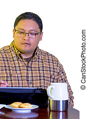 Middle Age Man Using Tablet And Drinking Coffee