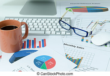 business charts or graphs and coffee with eyeglasses