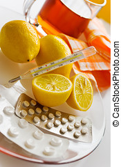tea with lemons and flu pills with thermometer - grippe...