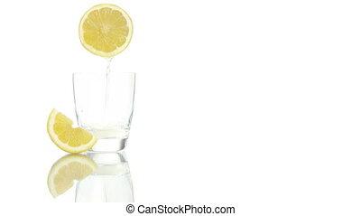 squeezed lemon juice poured glass - squeezed lemon juice...