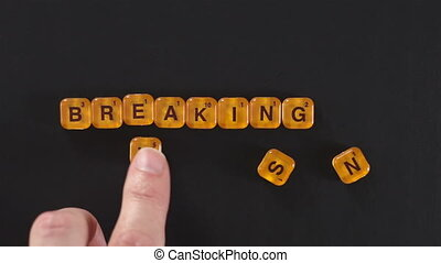 Letter Blocks Spell Breaking News - A close up shot of a man...