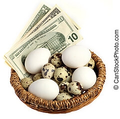 Nest with eggs vertical - A basket containing money and all...
