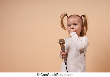 Girl With Microphone - Little Girl With Pony Tails Holding...