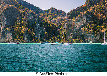 Sailboats in a tropical lagoon