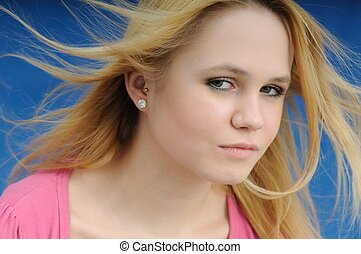 Beautiful teenager with wind in hair