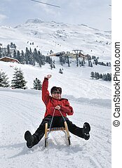 Senior woman on sledge having fun - Winter people series -...