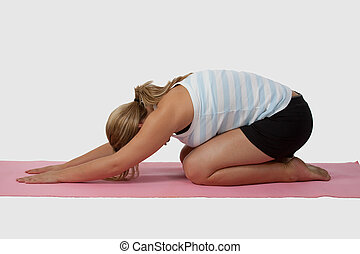 Yoga pose - Blond caucasian woman wearing workout attire on...