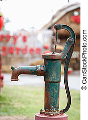 Old vintage water pump in the garden