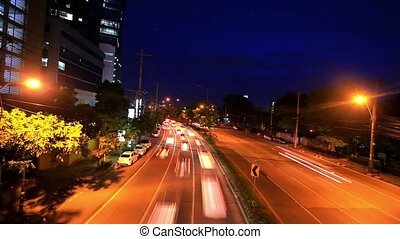 Traffic on a road in the city centre Night time Bangkok,...