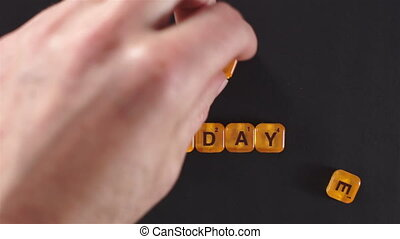 Letter Blocks Spell Holiday Sale - A close up shot of a man...