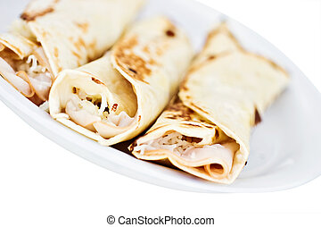 Turkey and cheese wrapped in tortillas