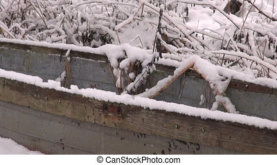 old abandoned wooden boat on snow - old abandoned wooden...