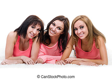Three beautiful young women posing