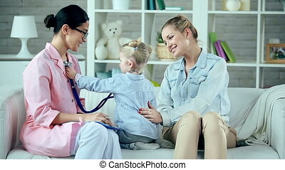 Doctor in Future - Pediatrician and little patient changing...