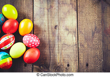 Painted eggs - Easter symbols on wooden background